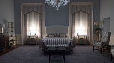 Claire Underwood's bedroom on House of Cards. Love the couch at the foot of the bed.