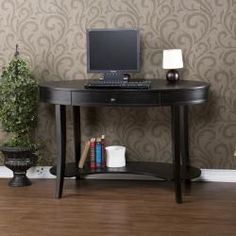 @Overstock - The oval shape and black finish highlight this writing desk.  The unique design allows this desk to double as an entry console table. http://www.overstock.com/Home-Garden/Belmont-Ebony-Oval-Desk/5299264/product.html?CID=214117 $196.19