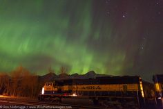 Northern Lights dancing above an engine from the Alaska Railroad, Seward, Alaska.