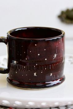 If the coffee isn't enough to wake you up, the hand-painted galaxy on this mug should do the trick
