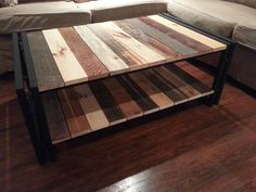 Mixed reclaimed wood with metal frame and lower shelf coffee table by ArtistandCarpenter on Etsy