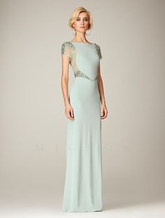 Full-length formal dress featuring beaded cap shoulders and waist, bateau neckline bodice.