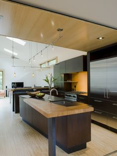 Bamboo floors offer such clean and light feel to a room.  Great kitchen!