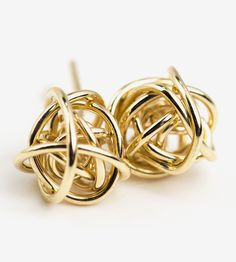These love knot stud earrings are handmade.