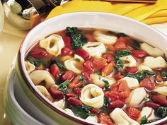 tortellini bean soup 20 minutes to prepare: 3 1/2 cups water   2 vegetarian vegetable bouillon cubes   1 (14.5-oz.) can diced tomatoes with basil, garlic and oregano, undrained   1 cup frozen cut leaf spinach   1 (15.5-oz.) can kidney beans, drained, rinsed   1 (9-oz.) pkg. refrigerated cheese-filled tortellini Ovo Vegetarian, Vegetarian Recipes Easy, Soup Recipes, Vegetarian Options, Bean Recipes, Fall Recipes, Yummy Recipes, Cooker Recipes, Lemon Squares