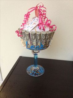 Idea for 21st birthday! 21 dollar bills around margarita glass. Stuff candy, gift cards, lotto tickets, etc. in the middle. Use 3D squeezable paint to decorate the glass.