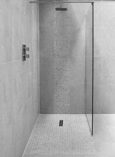 A walk in shower is a great choice for a sleek and modern bathroom #wetroom #walkinshower #bathroom #greybathroom #bathroomdesign