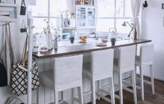 Do you really need a dining table? Put a breakfast bar cum kitchen counter in the centre of a small living area to save space | Kaoli's all-white house in Tokyo, #IKEAFAMILYMAG
