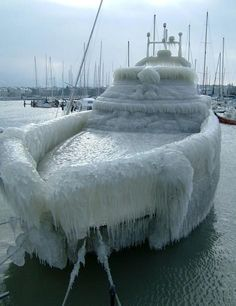 Check this out! A boat in #Seattle frozen in ice storm! Via @ArizonaWeather