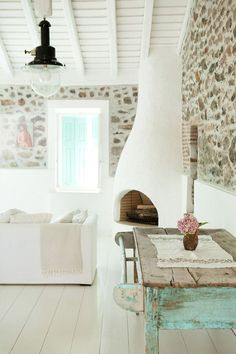 Pure escapism today. I admit I am totally obsessed with owning a holiday house on a Greek isle. And this one would be my ideal second home. I love the bare brick walls inside and out, the gorgeous ...