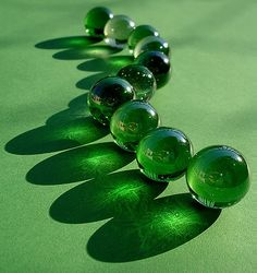 A Line of Green Glass Marbles ....