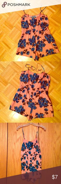 PinK Blue Floral Romper. Runs Medium Genady's Floral Romper. Without Tags. New. Size Tag says Large but runs like a Junior Medium. Color is like Peach/Lt. Pink Genady's Pants Jumpsuits & Rompers