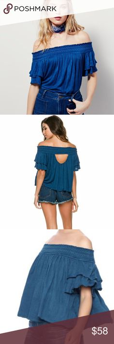 free people • off shoulder cutout back top Free People 'Sanorini' top in blue  Standout in this stunning blue off shoulder top with a cutout back. A smocked, shoulder-baring neckline and flirty back cutout create sun-loving vibes in a swingy gauze top styled with tiered short sleeves for extra flounce. 97% rayon, 2% polyester, 1% spandex. Dry clean or machine wash cold.   size: large condition: new with tags Free People Tops Tees - Short Sleeve