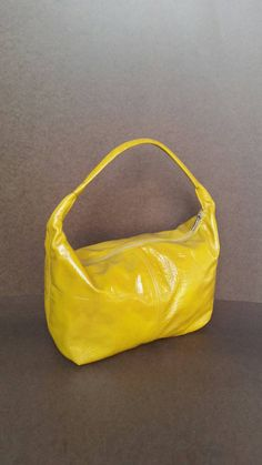 Check out this item in my Etsy shop https://www.etsy.com/listing/250328557/yellow-leather-hobo-purse-unique-bag