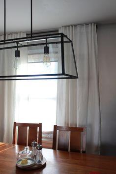 White Ikea Aina curtains (with a Ballard light fixture)
