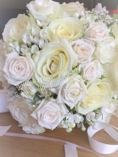 Stylish white / ivory cream rose hand tied bride bouquet with gypsophila and bouvardia - designed and created by Willow House Flowers Aylesbury Wedding Florist - www.willowhouseflowers.co.uk