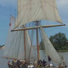 STV Pathfinder - Parade of Sails - This is a view of STV Pathfinder moving up the Saginaw River toward Bay City, Bay County, Michigan, US. This was the Parade of Sails (July 11, 2013), the official entrance of the tall ship fleet to start the Tall Ship® Celebration, part of the Tall Ships Challenge® Great Lakes 2013. This photograph was taken from the western approach of a railroad bridge just down river from Liberty Bridge near downtown Bay City.