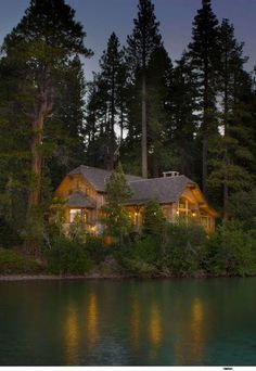 """My """"someday"""" log cabin nestled in the trees and by a gorgeous pond."""
