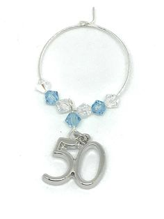 Silver plated Charm set with Aquamarine and Clear Swarovski Crystals make this gorgeous wine glass charm Aquamarine is the birthstone colour for March This gift is perfect with a bottle of bubbly. Swarovski Gifts, Swarovski Crystals, Wine Glass Charms, Personalised Gifts, Aqua Marine, Organza Bags, Birthstones, 50th, Silver Plate