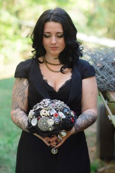 Brooch bouquet & stunning bride in black wedding dress ~ Jared & Michelle's offbeat, Til Death Do Us Part Halloween wedding in Maryland. Images by Marcella Treybig Photography.