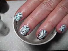 Water Marble on SHORT NAILS - Blue, Brown & White Nail Art Tutorial. This is really cool! Layer nail polish in a water cup, create a design, and dip nails in. Super easy!
