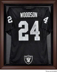 """The Oakland Raiders brown framed logo jersey display case is made from a durable, high strength injection mold backing, and then encased by a beautiful brown wood frame. The inner dimensions are 38"""" x"""