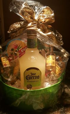 Liquor GIFT basket / fundraiser ideas. I used small Jose Cuervo tequila in tall Margarita glasses & different flavors of Margarita flavors. Wrapped in clear gift bag. Use lemon lime colors and a gold bow on top. So cute!