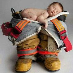 Vol. Fireman - Great newborn picture ideas in the future, I would like to do this with our new baby and Stephens Lineman equipment. .