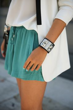 An edgy cuff brilliantly complements turquoise lounge shorts and matching polish. So chic, so summer.