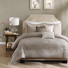 The Madison Park Channing duvet cover set provides a modern look through fabric manipulation. The taupe polyester charmeuse gives a slight sheen to the fabric, while the small pleating on the cover and and shams provides great dimension for your room.