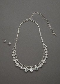 A simple and timeless style that is a must have for your jewelry box!  This beautiful crystal necklace and earring set has diamond and circle stones.  Available in silver.  Imported.