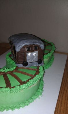 Toby the train cake for 3 year old birthday. Cake is a number 3 cut out, made to look like train tracks with a toby the train cake on top