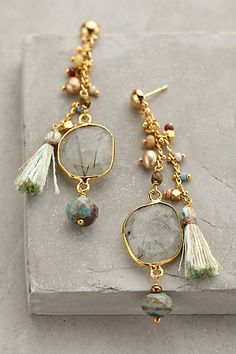 tassel earrings -i like the idea of using tassels to add an unusual texture