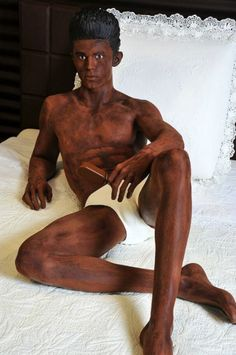 Designer Karl Lagerfeld of Chanel commissioned chocolate artist Anya Gallaccio to create a life sized chocolate statue that looks just like his favorite model/muse Baptise Giabiconi, wearing only his underwear