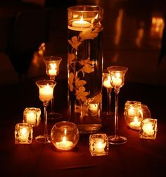 Really simple centerpiece that could be customized for any indoor party and could be done relatively cheaply.  White tea lights in inexpensive glass candle holders of varying heights.