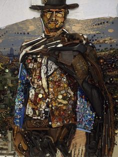 "French artist Bernard Pras uses junk and discarded materials to create his large-scale ""paintings"""