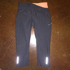 Nike Dri Fit Capris Grey and orange Nike Dri fit capris. They are in great condition as seen in the picture. Size Xs but they can also fit a small. Nike Pants Leggings