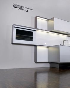 Poggenpohl Porsche Design P´7340 - For the sleekest of environments, trust in this partnership. When these two companies team up the result is as dramatic as it is revolutionary. The aluminum frame that surrounds these built-in cabinets sets them apart, providing different ways of attaching the units, making for a more dynamic display. For once, you can play with depth and mood with slick built-in lighting. Surfaces come in metallic finishes or wooden surfaces sporting full texture and…