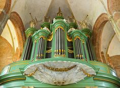 Looking up at the case and pipes of the stunning green, white and gilt pipe organ in Deventer church, the Netherlands. It was built in 1722 and has three manuals