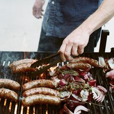 """""""Brats are about as Wisconsin as it gets,"""" says restaurateur Gabriel Stulman. For summer, he came up with a bright, lemony parsley sauce to go with the sausages, along with the classic accompaniments of grilled onions and mustard. Fall Recipes, Summer Recipes, Wine Recipes, Sausage Recipes, Beef Recipes, Recipies, Grilled Sausage, Grilled Bratwurst, Summer Dishes"""