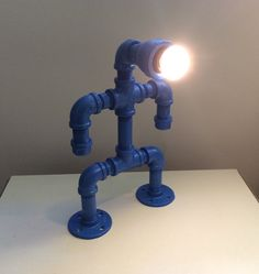 Check out this item in my Etsy shop https://www.etsy.com/listing/245736198/blue-pipe-man-lamp-reclaimed-steel-pipe