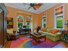 colorful living room with rainbow tye dye rug.  Grey Oaks in Naples, FL