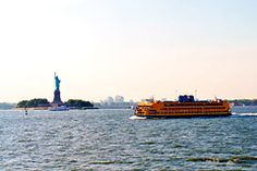 Manahattan to Staten Island, one of the world's most beautiful ferry rides.  About 65,000 riders board this orange commuter ferry every day. When you get on, head upstairs to snag a seat on the starboard (right) side—the best vantage point for admiring Ellis Island and the Statue of Liberty. The free 25-minute ride also delivers unobstructed views of the Manhattan skyline, stretching up and out from Wall Street.