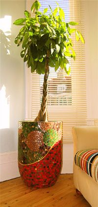 Large Mosaic Planter. This is a WOW piece. There are so many pretty colors In this piece, you could change the look of the room completely by just pulling a different color from the mosaic. BEAUTIFUL