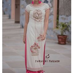 The popular birds and cages design crafted delicately on this gorgeous mirror embellished dress paired with palazzo pants. A beautiful ensemble indeed. 18 July 2017