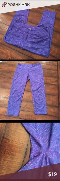 Athleta Capri Leggings Excellent used condition. No pilling. Colors are purple blue and gray. Pocket in the waistband. Women's size small. Inseam is 19.5 inches. Athleta Pants Leggings