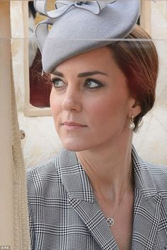 Still looking flawless: Kate, 32, wore her trademark heavy eyeliner and blushed cheeks for her appearance today