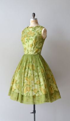 vintage late 1950s, early 1960s apple green silk chiffon dress with yellow floral under layer, fitted waist, full skirt and metal back zipper. ✂-----Measurements    fits like: medium  bust: 40  waist: 29  hip: free  length: 42  brand/maker: Carol Brent  condition: excellent    to ensure a good fit, please read the sizing guide:  http://www.etsy.com/shop/DearGolden/policy    ➸ visit the shop http://www.DearGolden.etsy.com  _____________________    ➸ blog | www.deargolden.com  ➸ twitter…