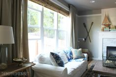 long family room curtains. Love this look for a casual family room with the combined wood blinds and curtains.