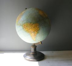 Beautiful and Rare Large French Antique G.THOMAS Earth Globe,on a wooden turned base,with a black patina,beginning of the 20 th century.circa
